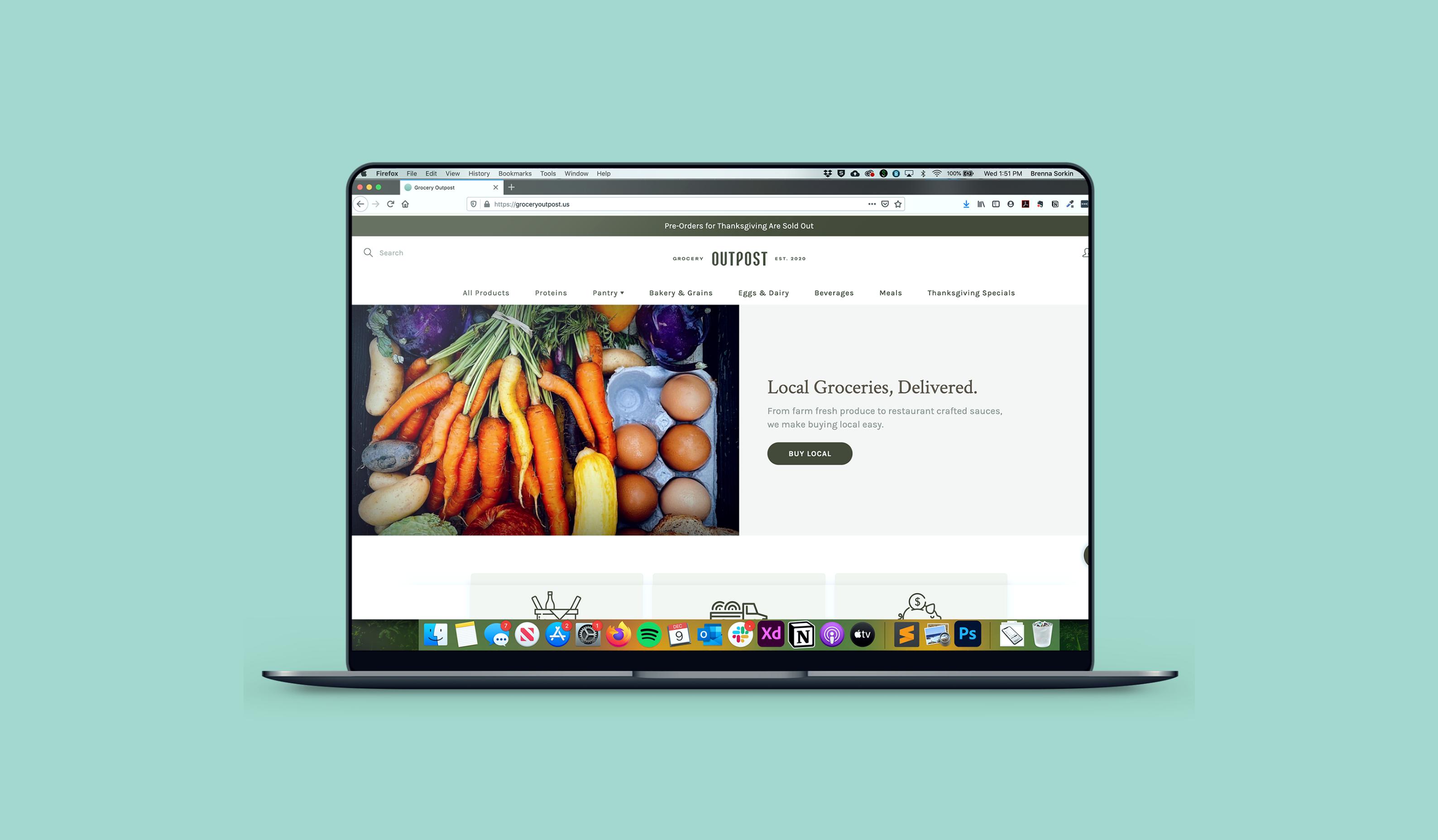 The Grocery Outpost website on a laptop screen